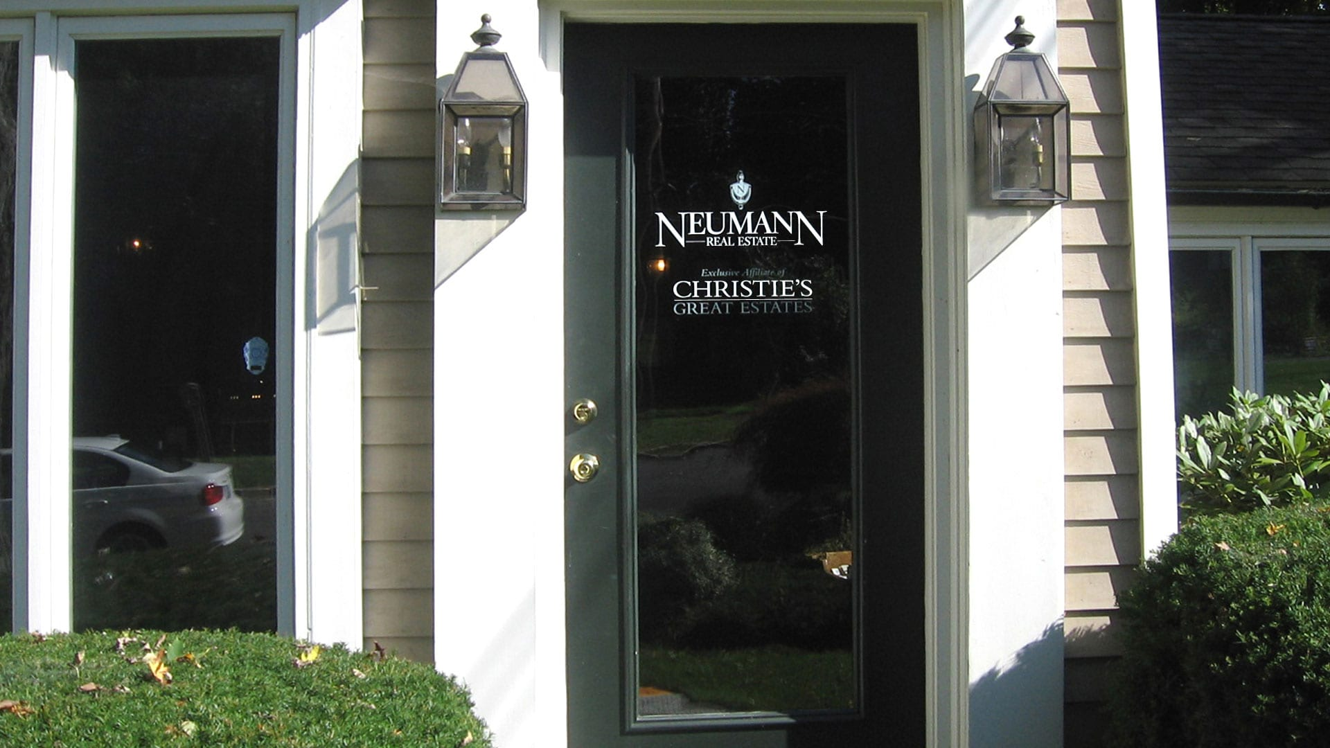 Neumann Real Estates - Door signs