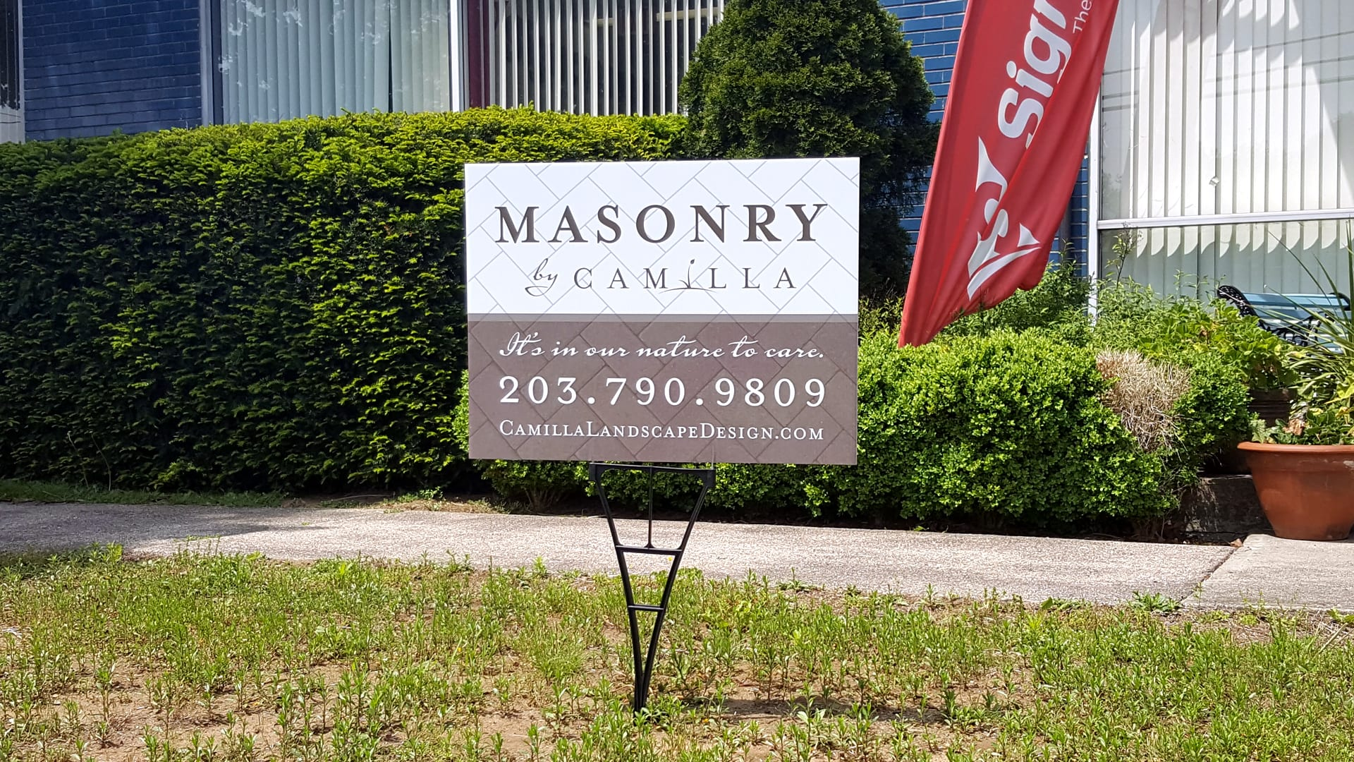 Outdoor coroplast sign with masonry outlines