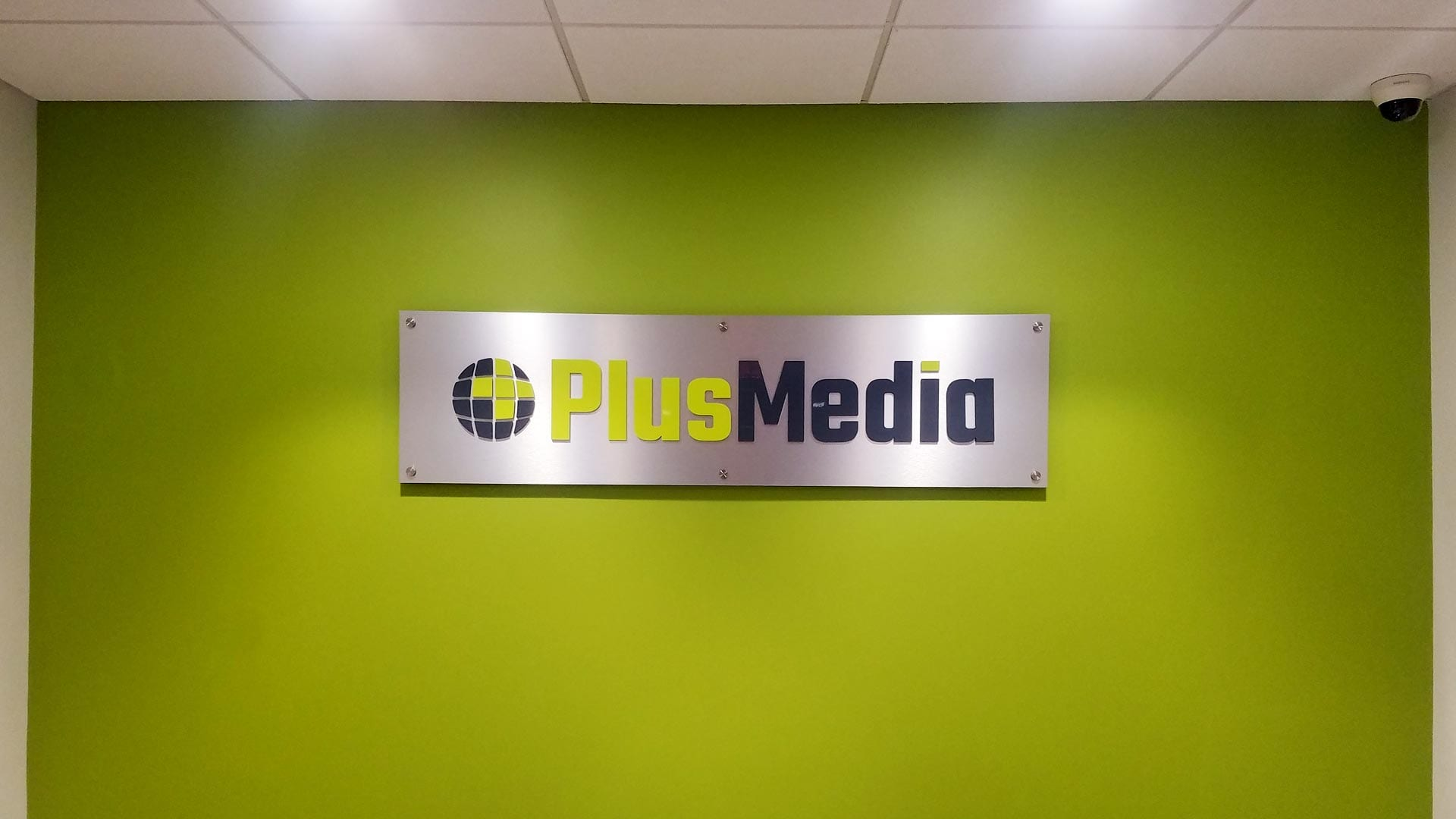 interior Wall sign at Plus Media
