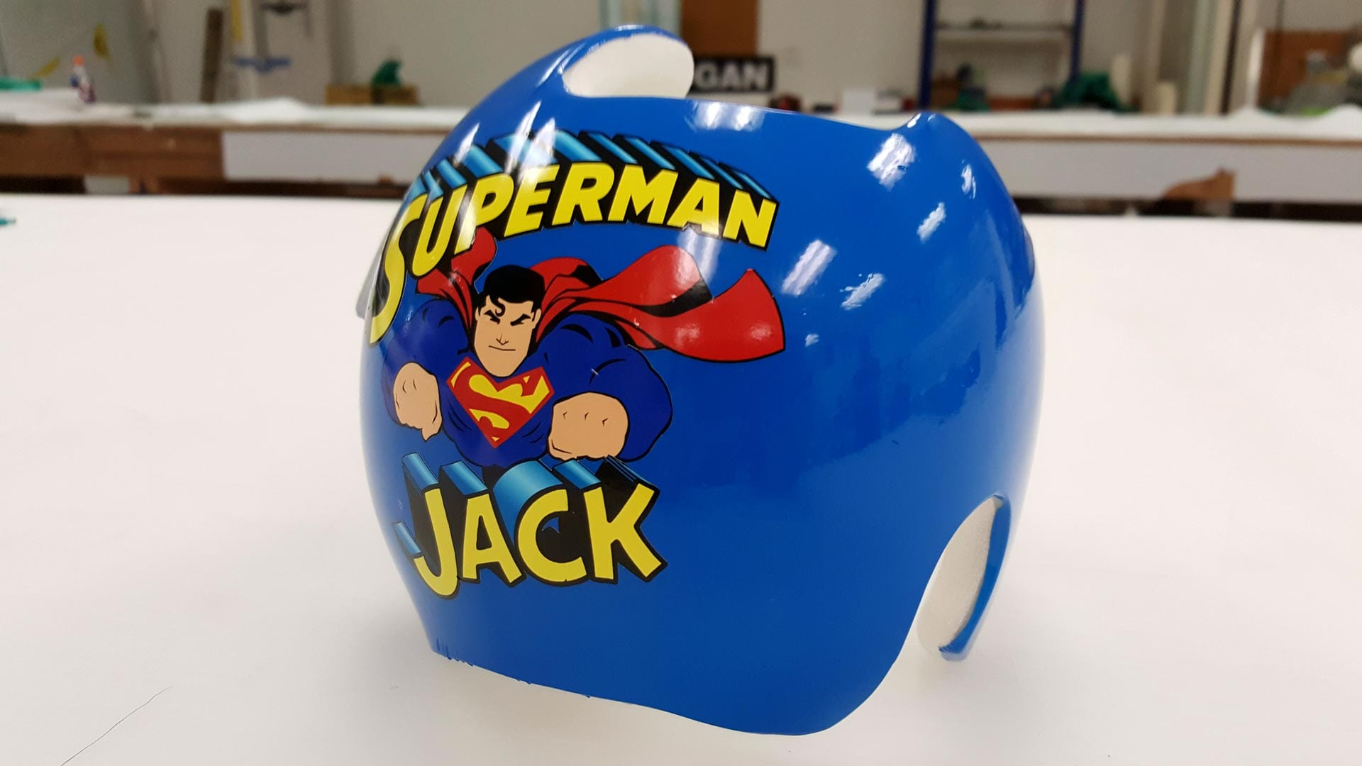 "Blue doc band sporting a ""Superman Jack"" logo"